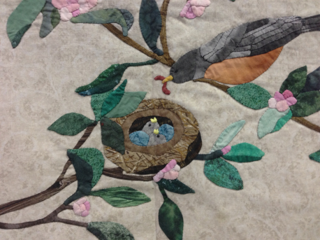 Detail of an appliquéd bird quilt by the late Carrie Honeman.