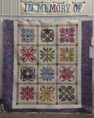This memorial quilt was appliquéd by Carrie Honeman, pieced by Laraine Facca and quilted by Bonnie Rhoby. The pattern was designed by Elizabeth Root.