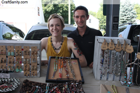 Caitlin Myler, creator of The Lucky Lark jewelry line, and her husband Stephen, sell her designs every Sunday at the Fulton Street Artisans Market in Grand Rapids, Michigan.