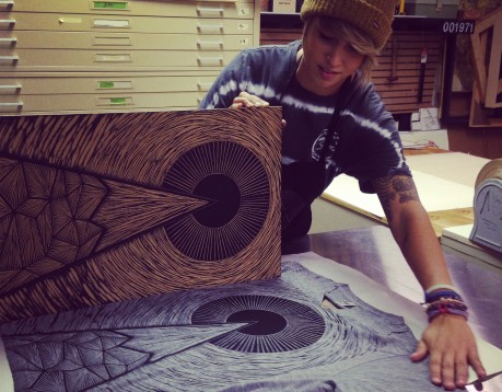 Grand Rapids printmaker Erica Lang carves wood blocks to print on T-shirts for her Woosah Outfitters brand. (Courtesy | Erica Lang)