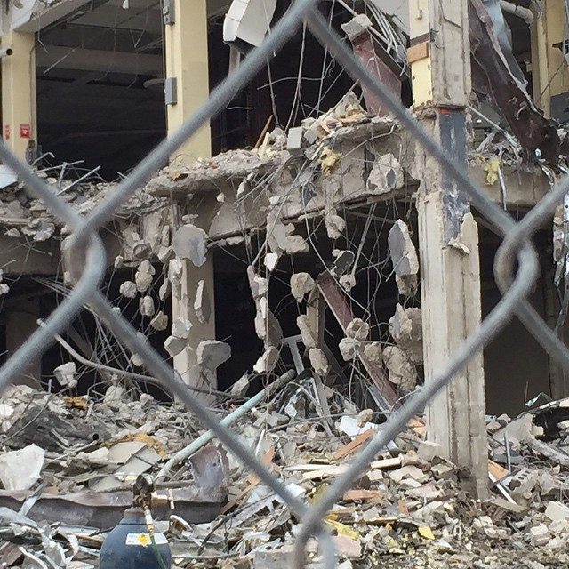 Through the fence concrete dangles like beads from the rebar. I have to walk away.  #grandrapidspress #demolition #newspaper #grandrapids #michigan #myoldworkplace