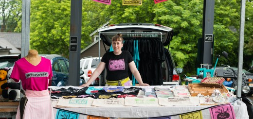 Jennifer in the CraftSanity booth on opening day of the Fulton Street Artisans Market in Grand Rapids, Michigan on June 14, 2015. Photo Credit: Jonathan D. Lopez